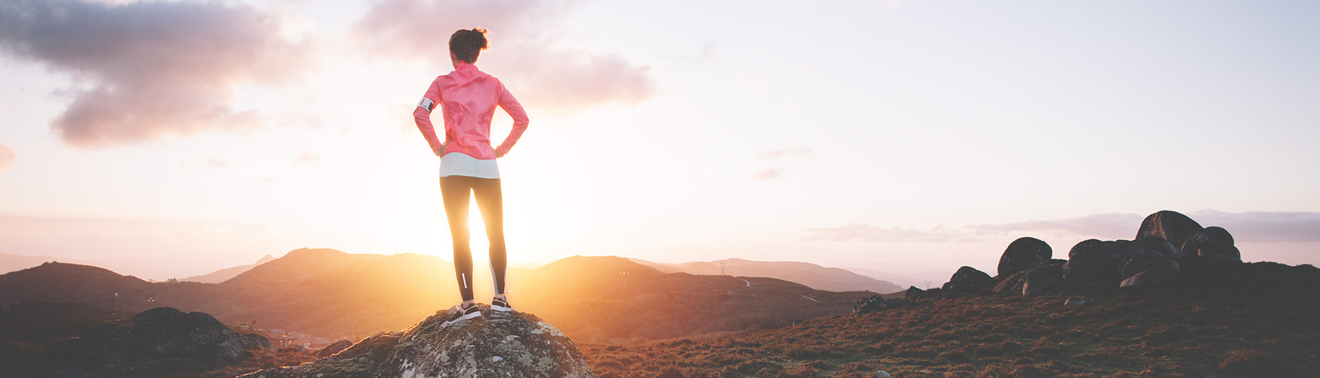 Sports woman examines mountain landscape for training on running